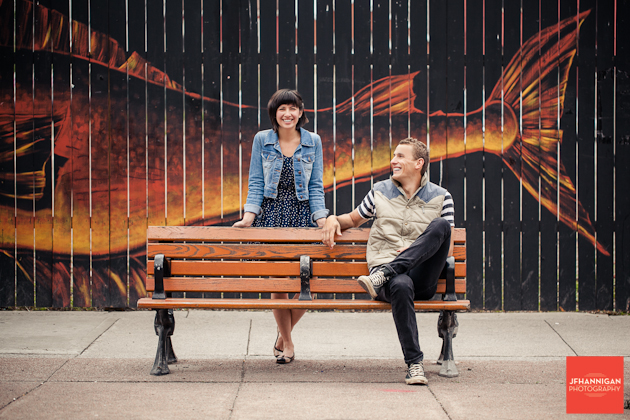 couple sits on Bench Mural Engagement