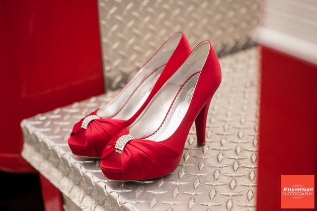 red bridal shoes on fire truck platform