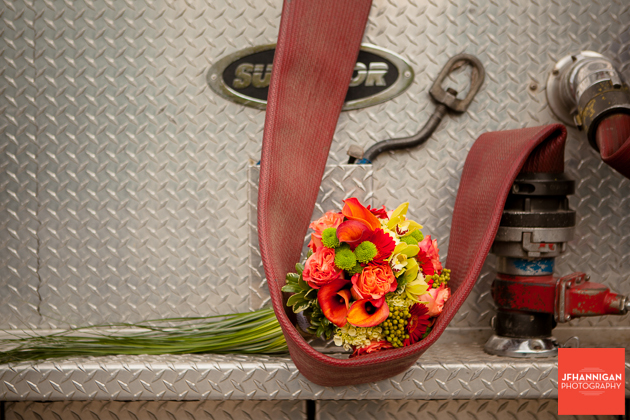 bridal bouquet on fire truck hose Niagara Wedding Photographer