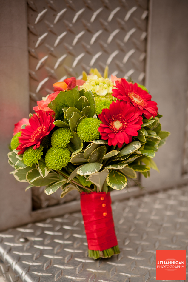 fall color bridal bouquet on fire truck platform