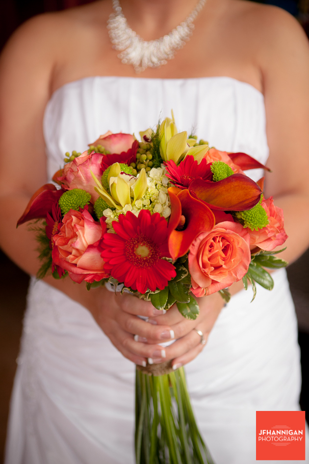 bride holding fall colored bouquet