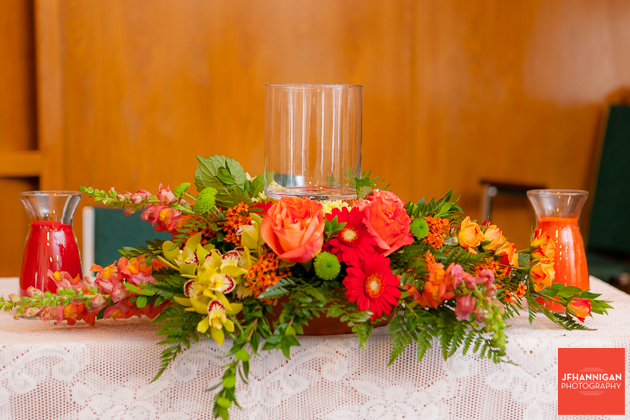 fall coloured flower arrangement at church