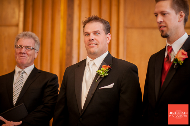 groom anticipates brides entrance at church