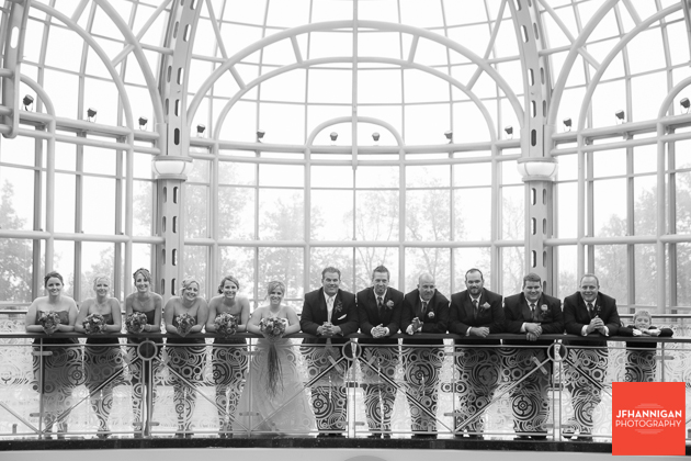 wedding party leaning on casino railing in atrium