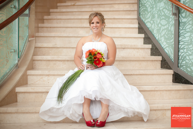 bride sitting on steps fall coloured bouquet