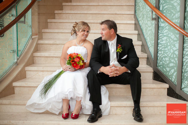 bride and groom sitting on steps fall accents