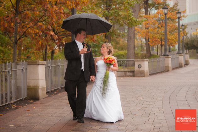 bride and groom walking in the rain fall folliage Niagara Wedding Photographer