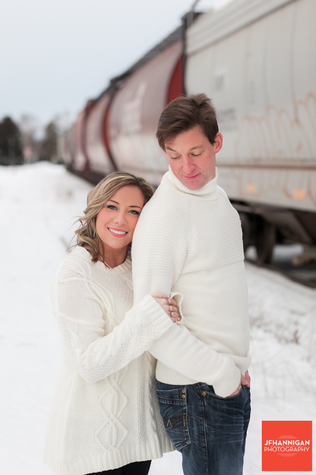 couple beside train cars dressed in white