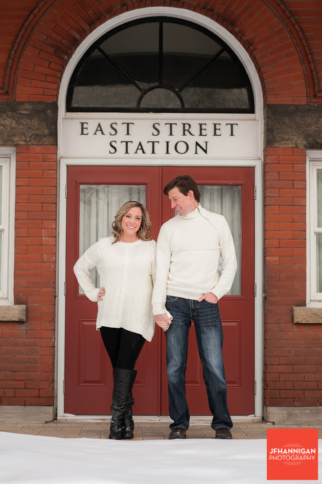 couple posed in front of door of Goderich train station