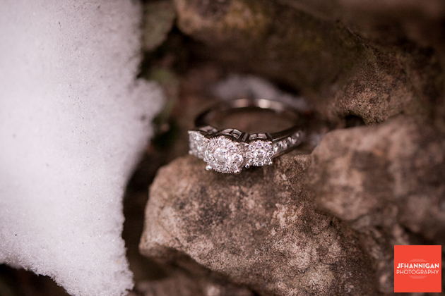 engagement ring set on rocks in snow