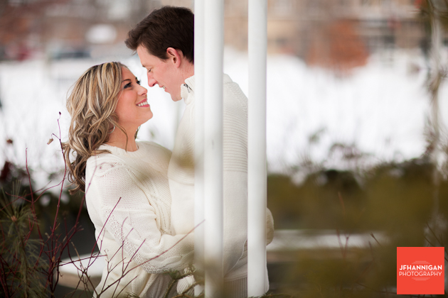 couple dressed in white engagement shoot in winter