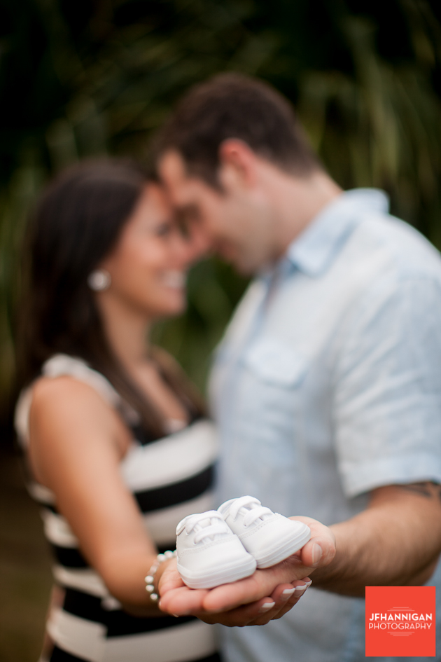 couple with baby shoes in hand