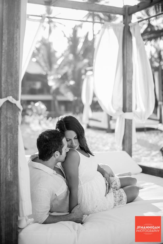 husband kisses shoulder of pregnant wife