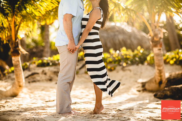 couple on beach with sand and palm trees
