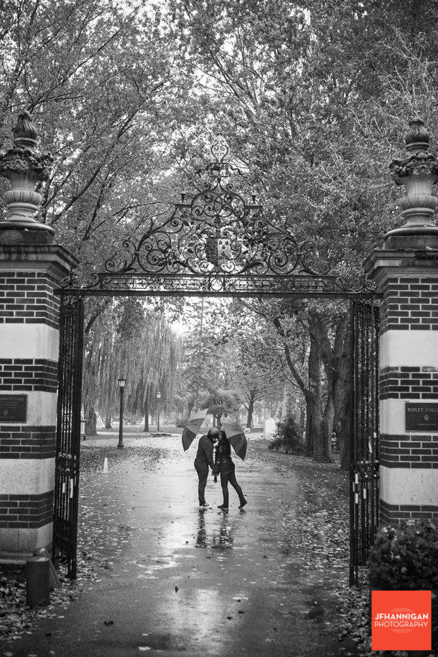 black and white, gate, umbrellas, Ridley College, Engagement Photo Shoot, Bride and Groom to Be, Niagara Wedding Photographer, Niagara Wedding Photography