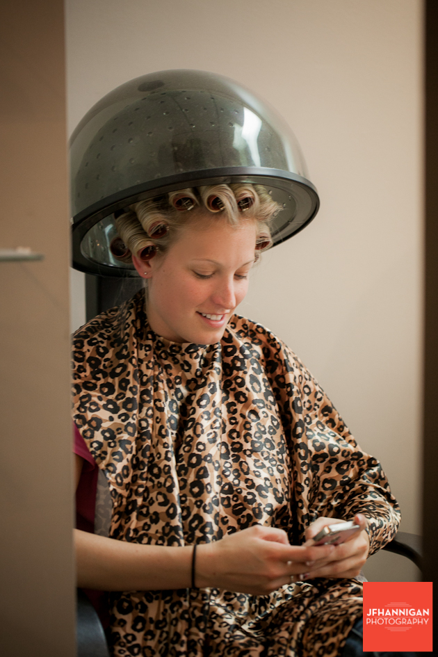 bride under hair dryer at slaon