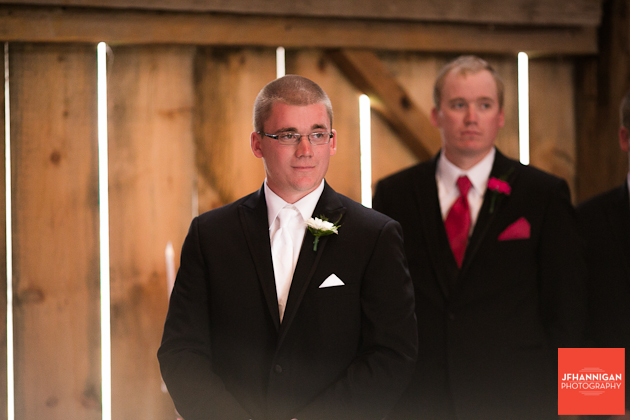 groom watches bride's entrance