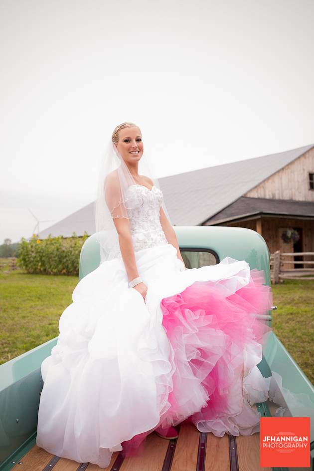 bride in back of antique truck