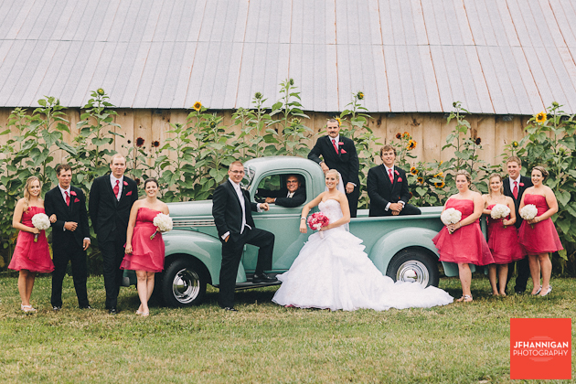 wedding party posed with antique truck