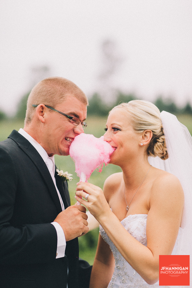 bride and groom eating cotton candy