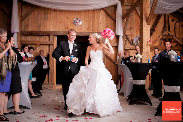 bride and groom's entrance of reception in barn