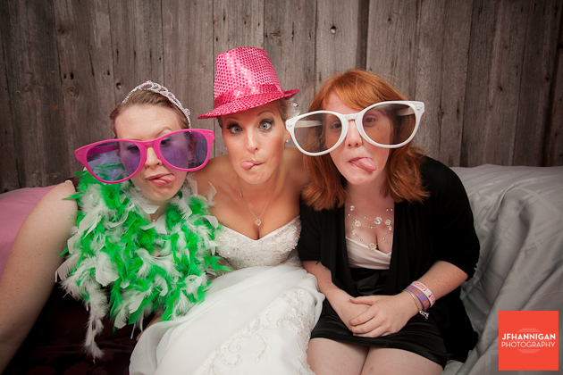 bride with guests in photobooth