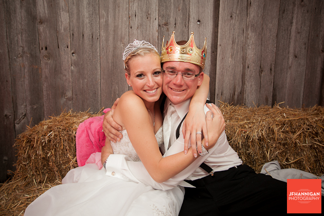 bride and groom dressed as king and queen in photobooth