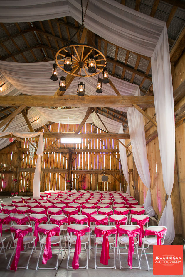 barn prepared with decorated folding chairs