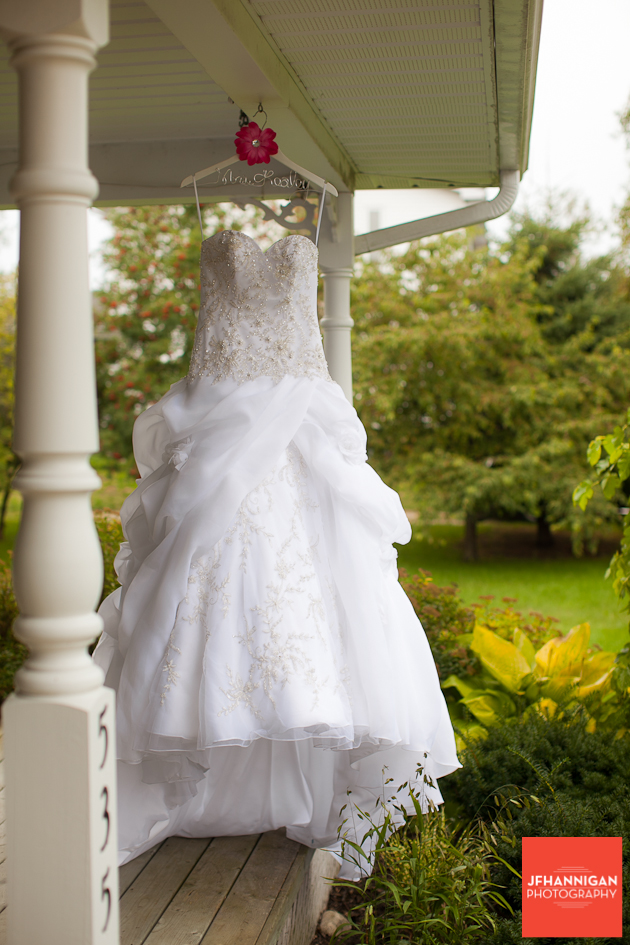 wedding gown hung on front porch