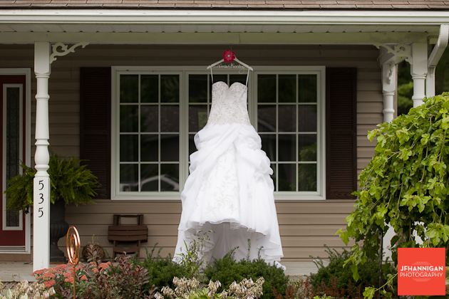 bridal gown hung on front porch