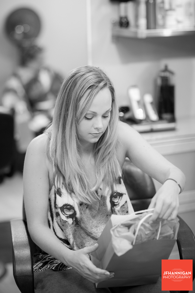 bride opens present at salon