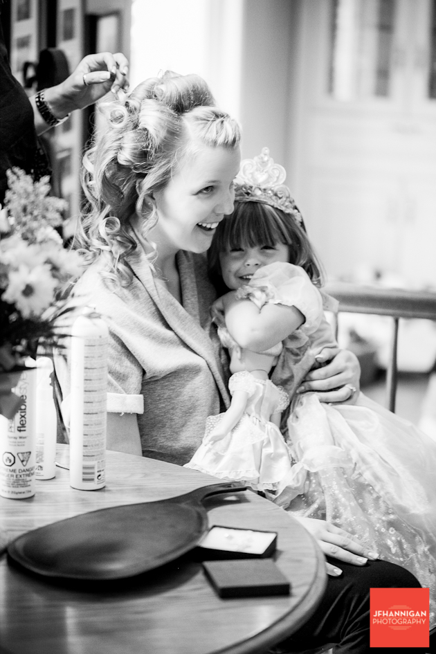 girl with child while getting hair ready black and white