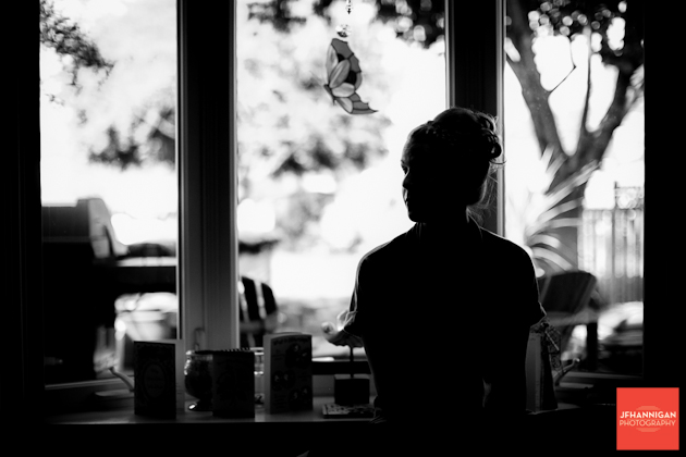girl sitting by window black and white silhouette