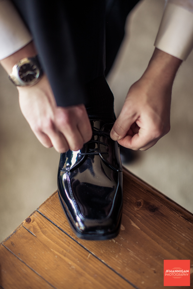 man tying a dress shoe