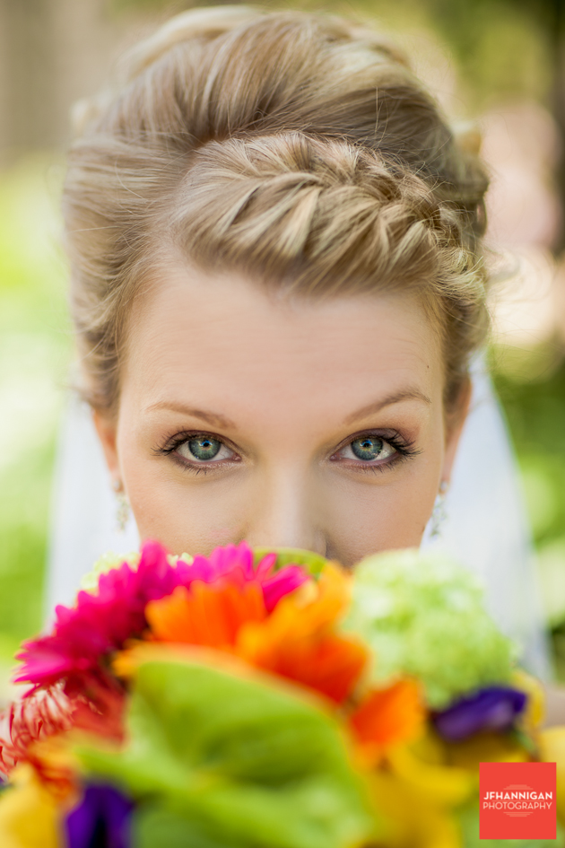 bride behind her colorful bouquet