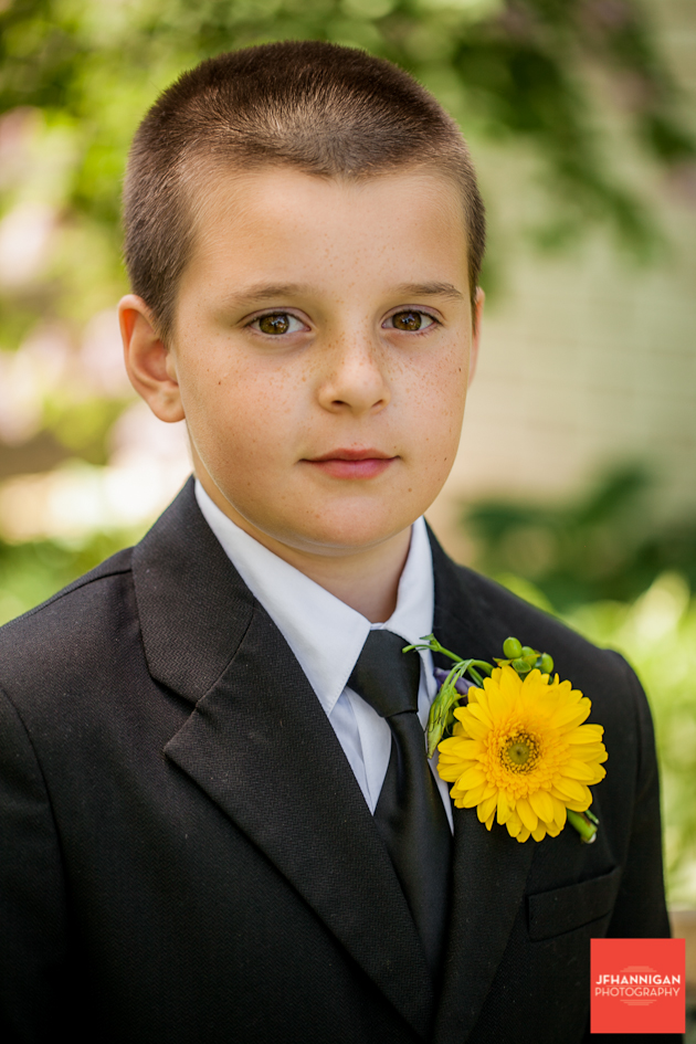 boy in suit with yellow flower