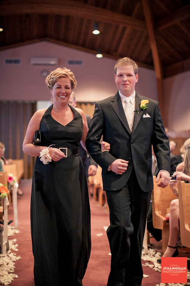 son walking mother down aisle