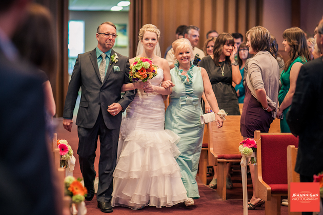bride walked down the aisle by parents