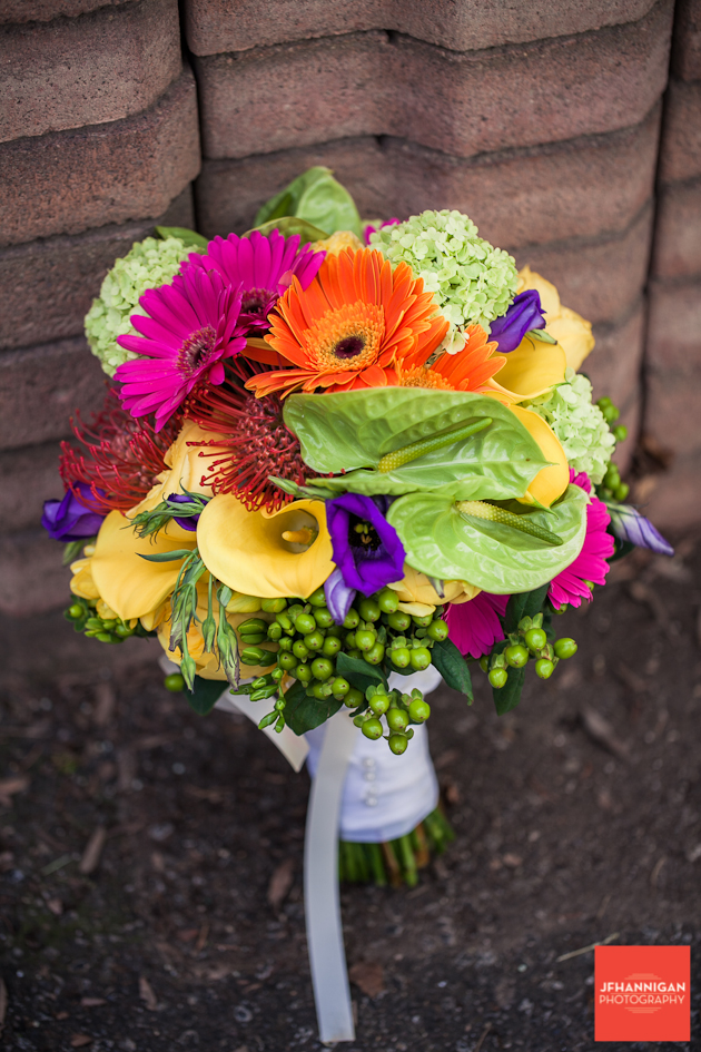 colorful bouquet against bricks