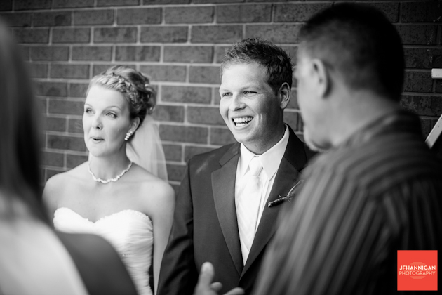 bride and groom greeting people black and white