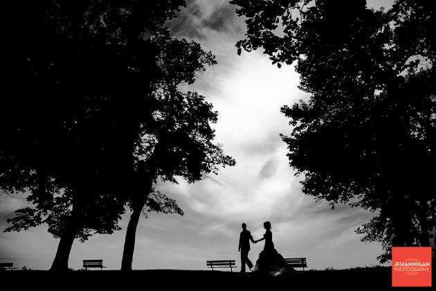 bride and groom in park silhouette black and white