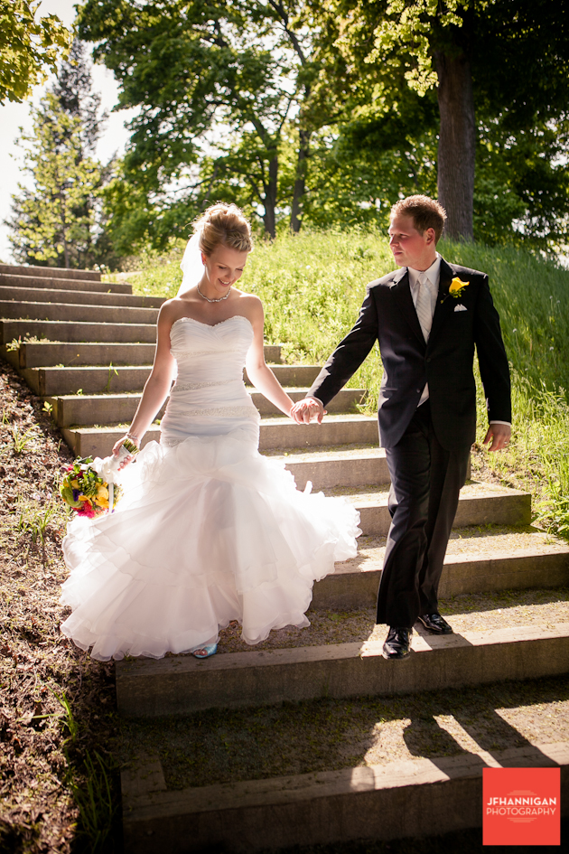 bride and groom walking down steps