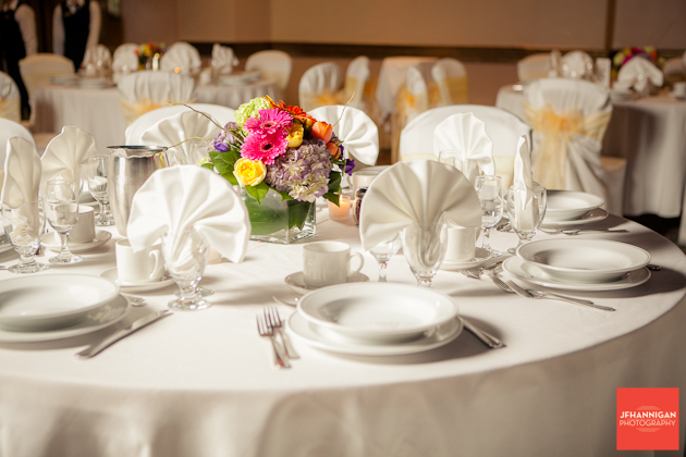 wedding reception table with colorful bouquet