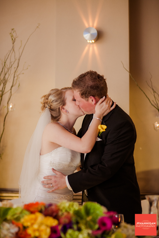 bride and groom kissing at wedding reception