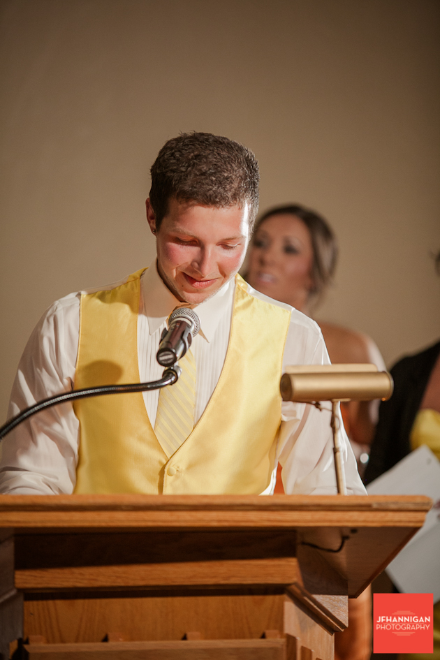 bestman giving speech at wedding reception
