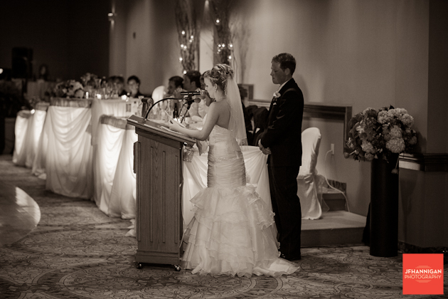 bride giving speech with groom