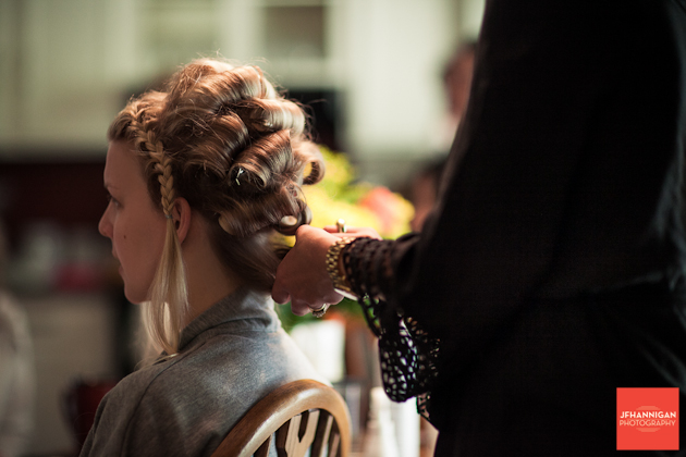 girl getting hair curled for wedding