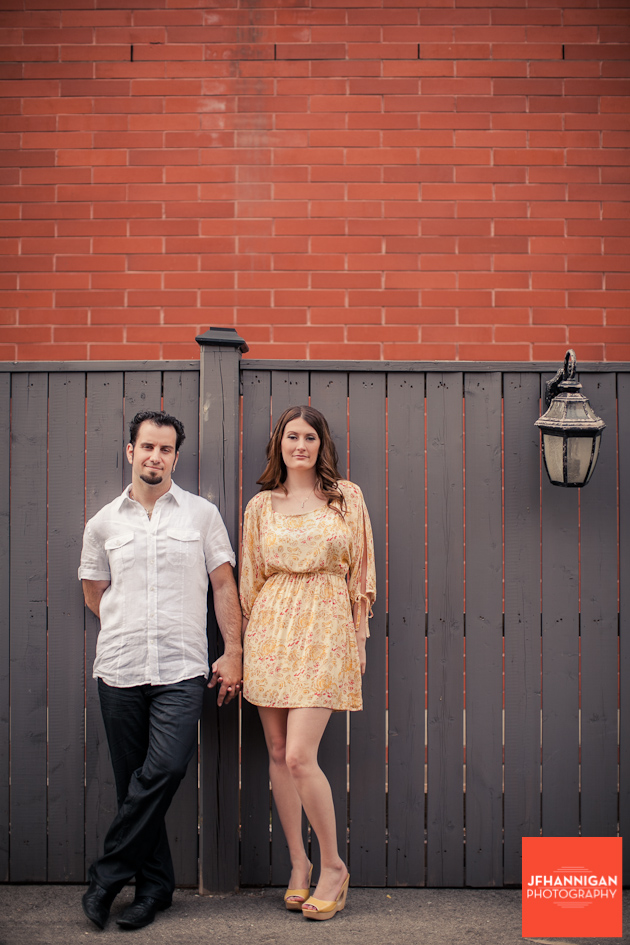 couple by fence, Burlington brick wall