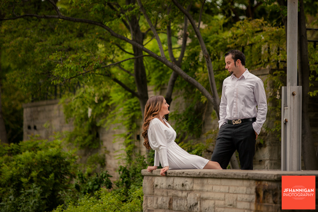 couple in courtyard, Burlington stone wall