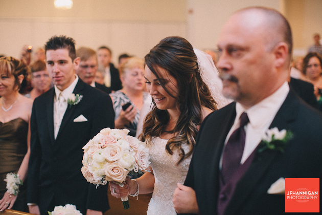 Father and daughter come down the aisle